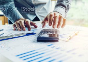 Business man Accounting Calculating Cost Economic concept